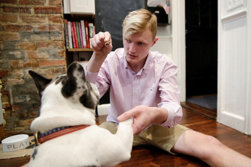 William Smith plays with his dog Hank at his home in Newburyport
