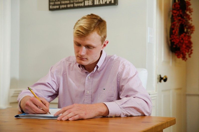 William Smith does homework at his home in Newburyport