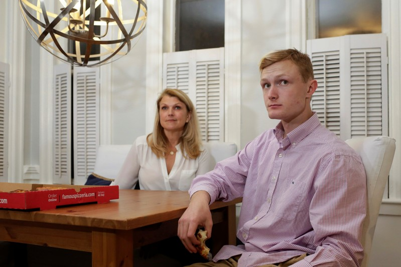 William Smith and his mother Kristen Smith are interviewed by Reuters in Newburyport