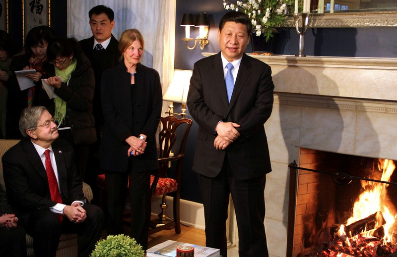 FILE PHOTO: China's Vice President Xi Jinping (R) talks with area residents in the home of