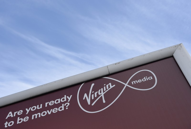 A billboard advertising Virgin media fibre broadband is seen in London, Britain