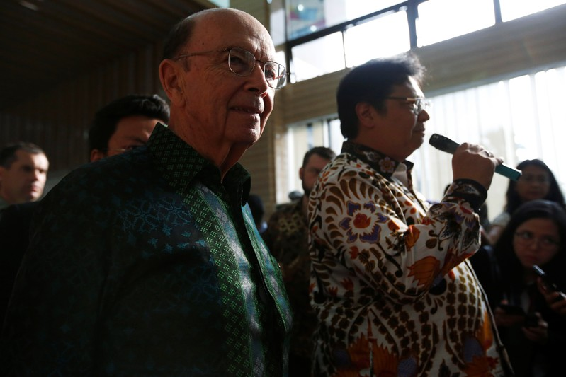 U.S. Commerce Secretary Wilbur Ross reacts as Indonesia's Chief Economic Minister Airlangga