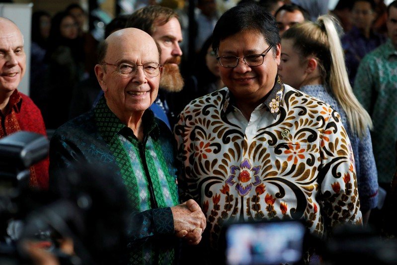 U.S. Commerce Secretary Wilbur Ross shakes hands with Indonesia's Chief Economic Minister