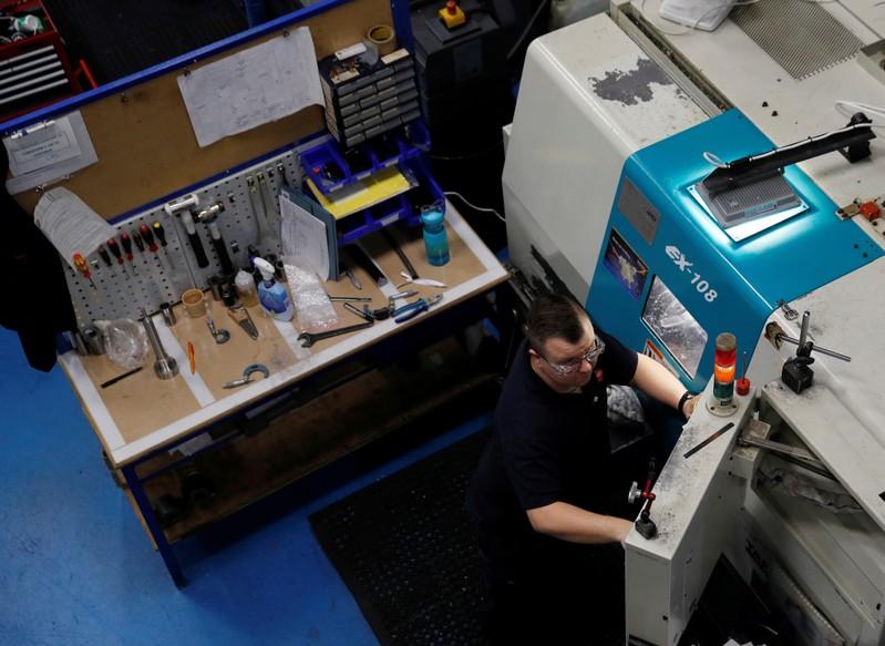 Engineer monitors a precision lathe at Swiftool Precision Engineering Ltd's facility near