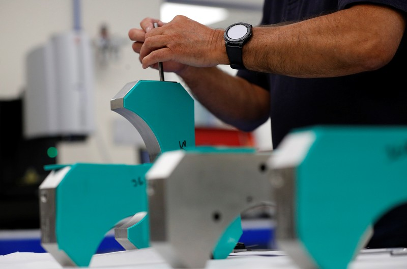 Engineer carries out quality control work at Swiftool Precision Engineering Ltd's facility near