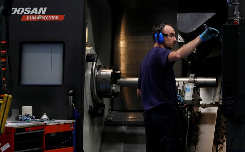 Engineer works on a precision lathe at Swiftool Precision Engineering Ltd's facility near
