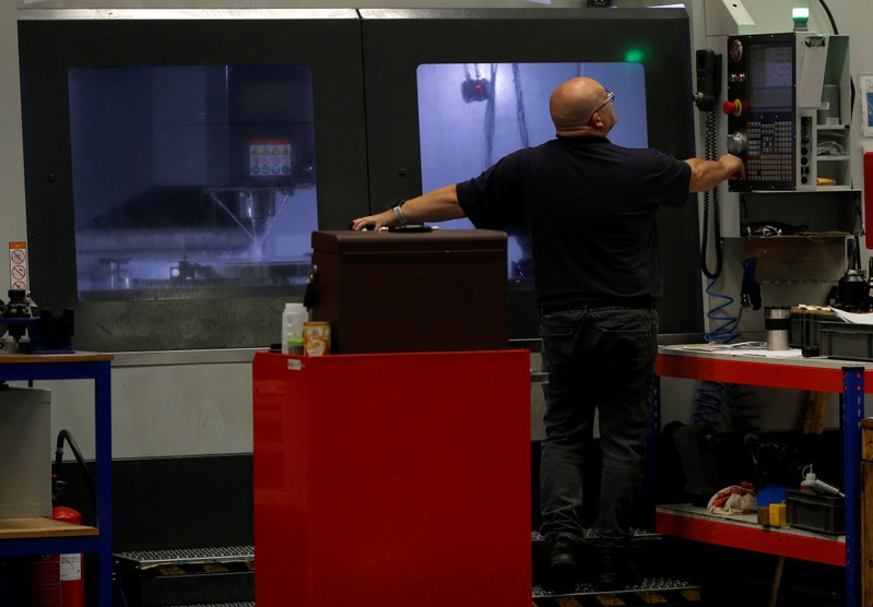 Engineer monitors a milling machine at Swiftool Precision Engineering Ltd's facility near