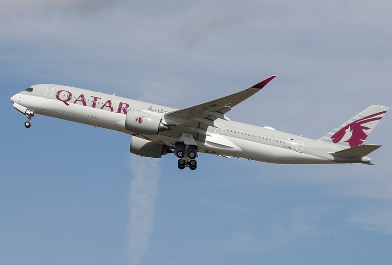 A Qatar Airways aircraft takes off at the aircraft builder's headquarters of Airbus in