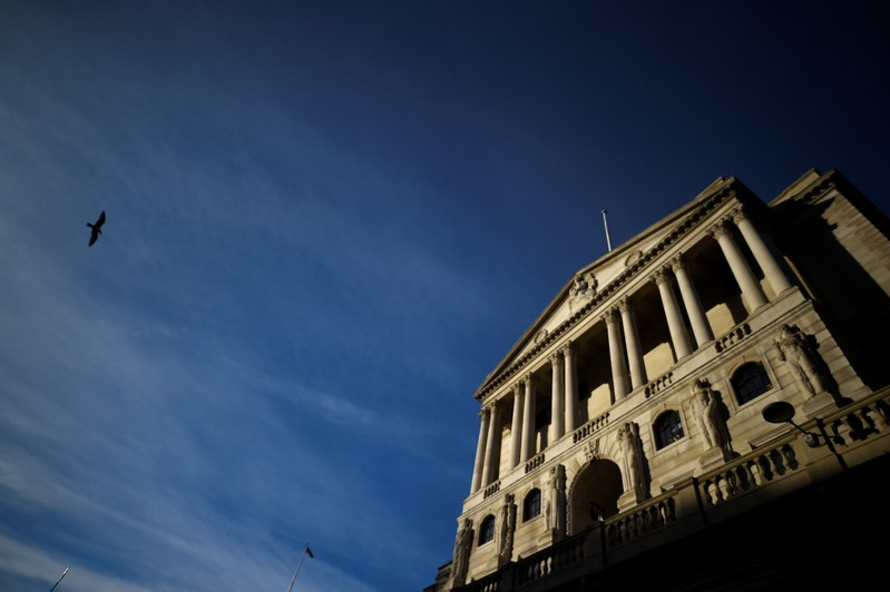 A bird flies past The Bank of England in the City of London