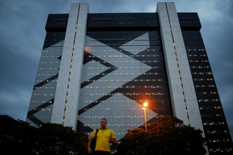 A man walks in front of Banco do Brasil headquarters building  in Brasilia