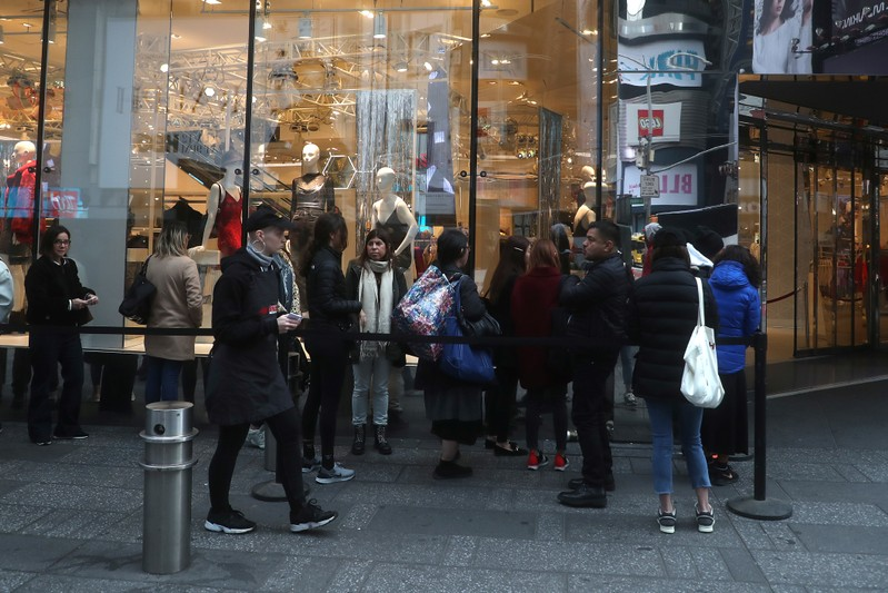 People line up to get into the H&M store for the Giambattista Valli collection in Times Square