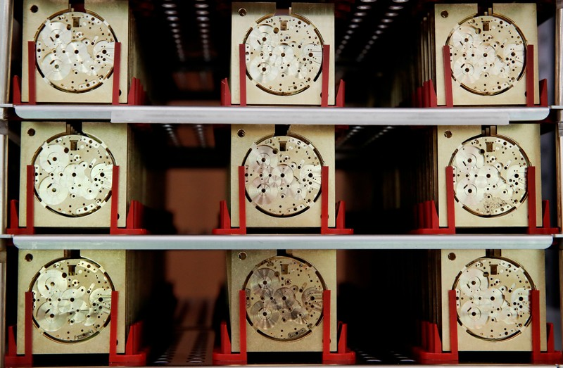FILE PHOTO: Movement plates for watches of Swiss watch manufacturer IWC are seen at its new