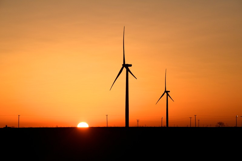 FILE PHOTO: Wind turbines operate at sunrise in the Permian Basin oil and natural gas