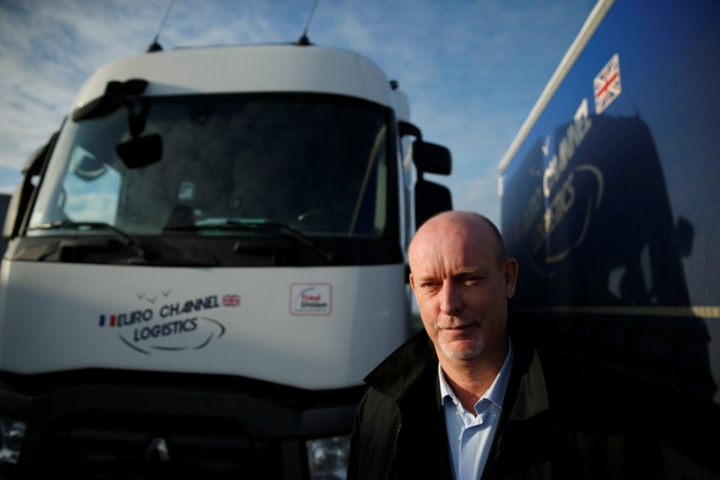 Bruno Beliard, founder and CEO of Euro Channel Logistics, poses in front of his trucks in