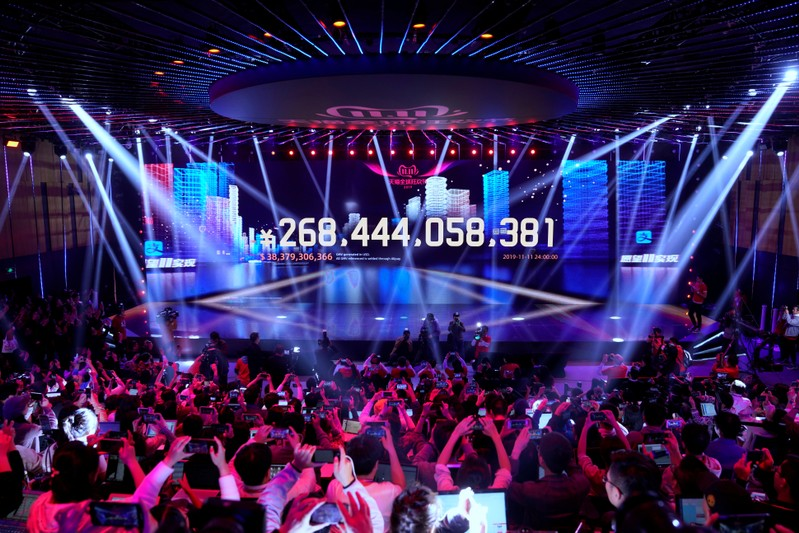 Screen shows the value of goods being transacted during Alibaba Group's Singles' Day global