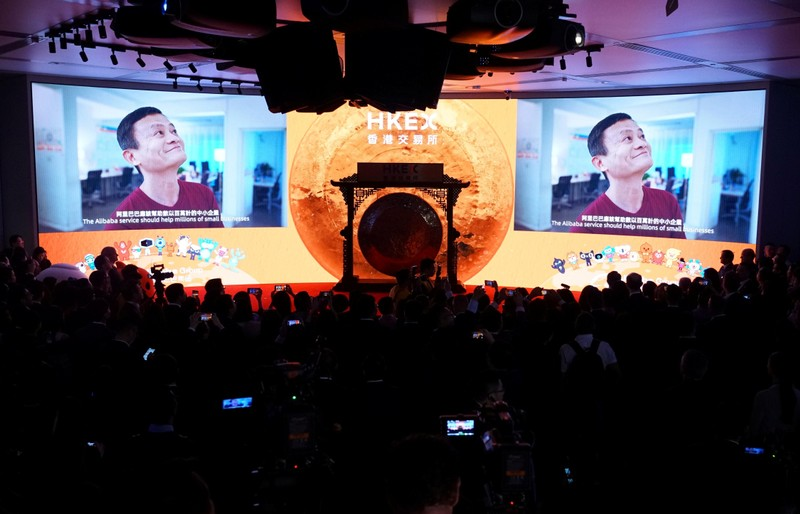 Alibaba's co-founder Jack Ma is seen on the screen at Alibaba Group's listing ceremony at the