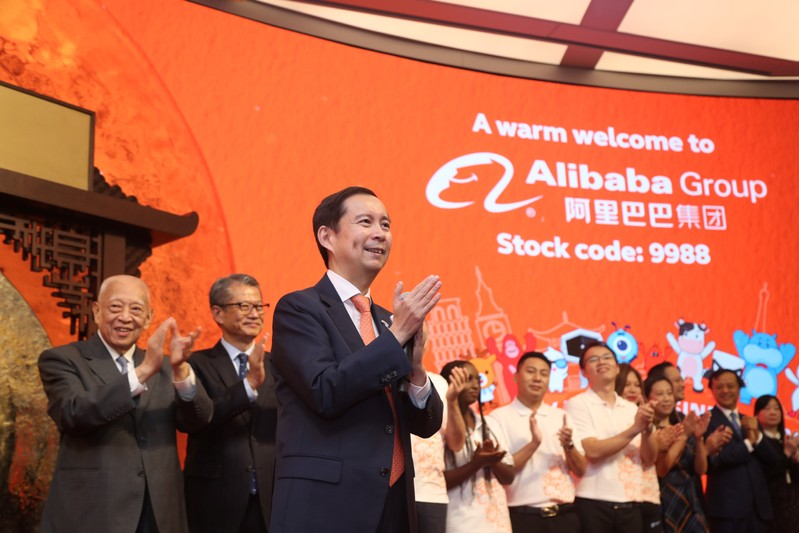 Daniel Zhang, Paul Chan and Tung Chee-hwa attend Alibaba Group's listing ceremony at the Hong