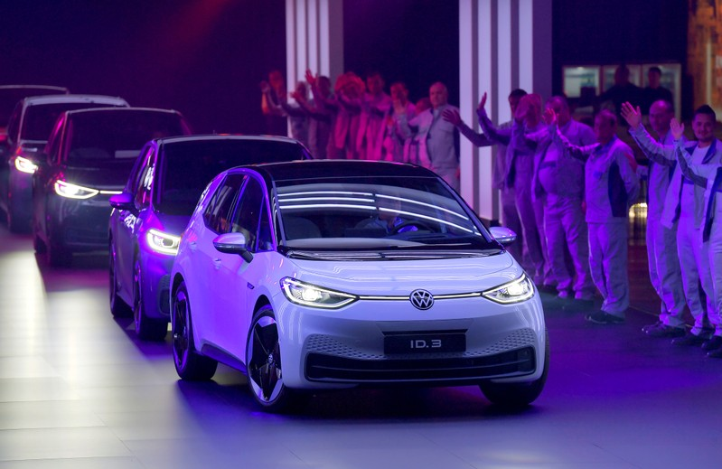 FILE PHOTO : New cars drive during a ceremony marking start of the production of a new electric