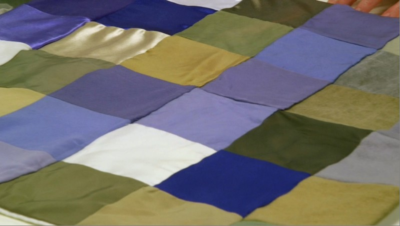 Patchwork of different types of material dyed using bacteria in a lab at biotech firm Colorifix