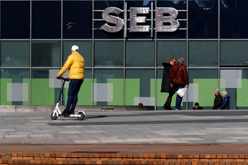 FILE PHOTO: People walk past SEB bank sign in Vilnius
