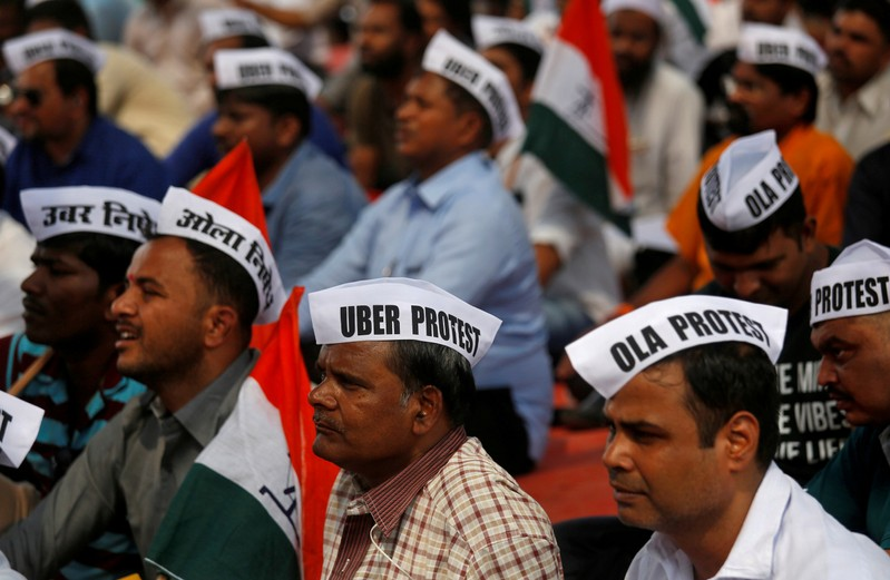 FILE PHOTO: Ola and Uber drivers are seen wearing caps during a protest against Ola and Uber in