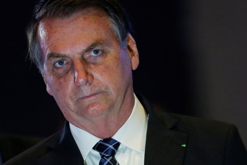 Brazil's President Jair Bolsonaro looks on during the event