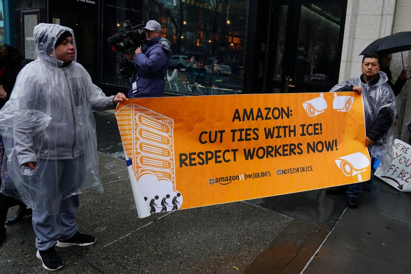 People take part in a rally against Amazon and their business practices in the Manhattan