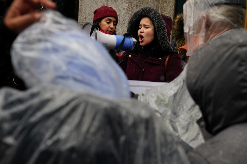 A woman takes part in a rally against Amazon and their business practices in the Manhattan