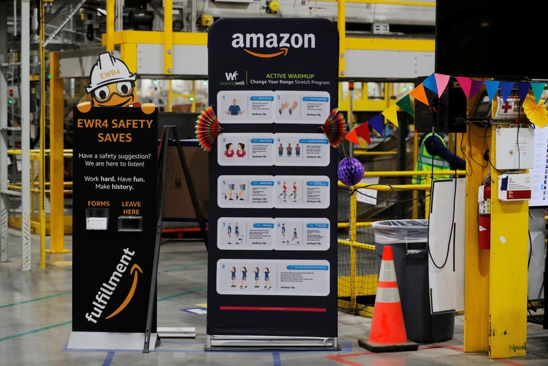 Exercise tips and safety instructions are displayed inside of an Amazon fulfillment center on