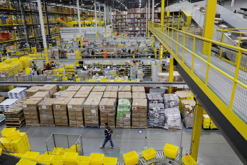 Amazon workers perform their jobs inside of an Amazon fulfillment center on Cyber Monday in