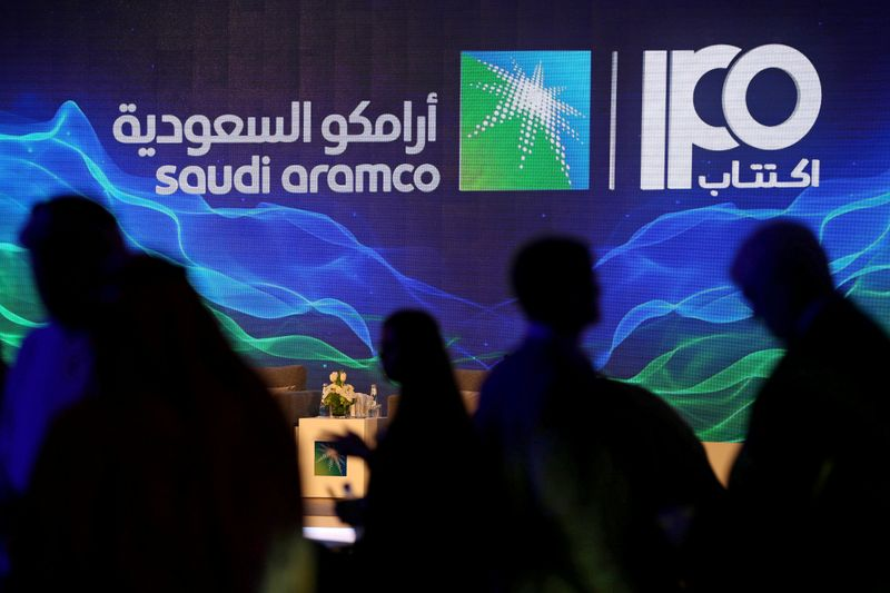 FILE PHOTO: Sign of Saudi Aramco's IPO is seen during a news conference by the state oil
