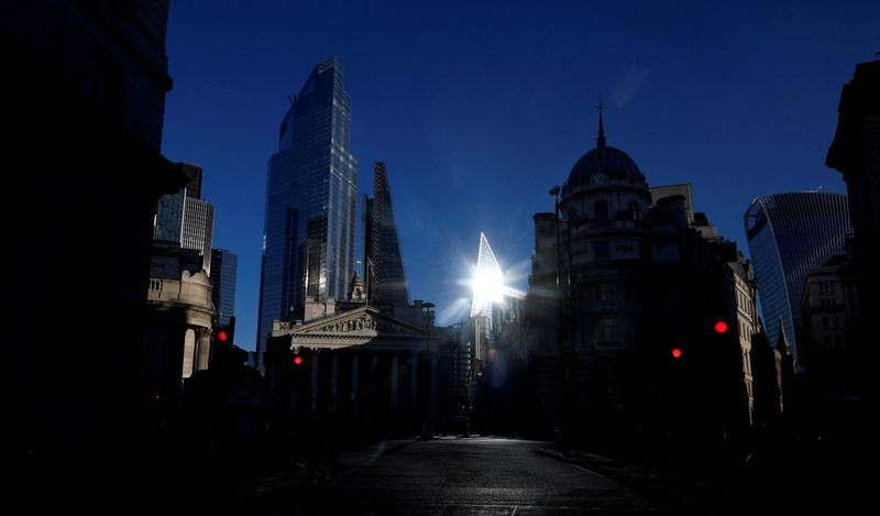 FILE PHOTO: The sun reflects off a skyscraper in the City of London