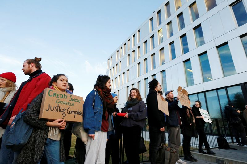 Activists protest outside the District Court of West Lausanne before the trial of twelve