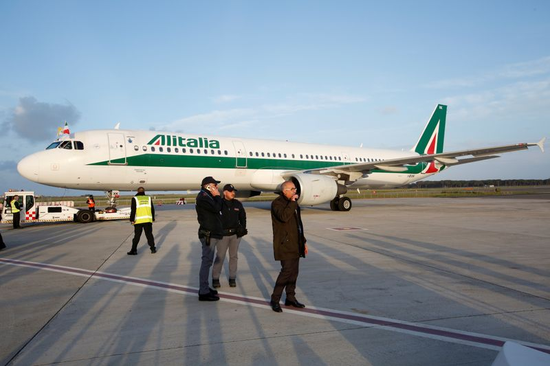 FILE PHOTO: The Alitalia plane carrying Pope Francis is seen at Fiumicino airport in Rome