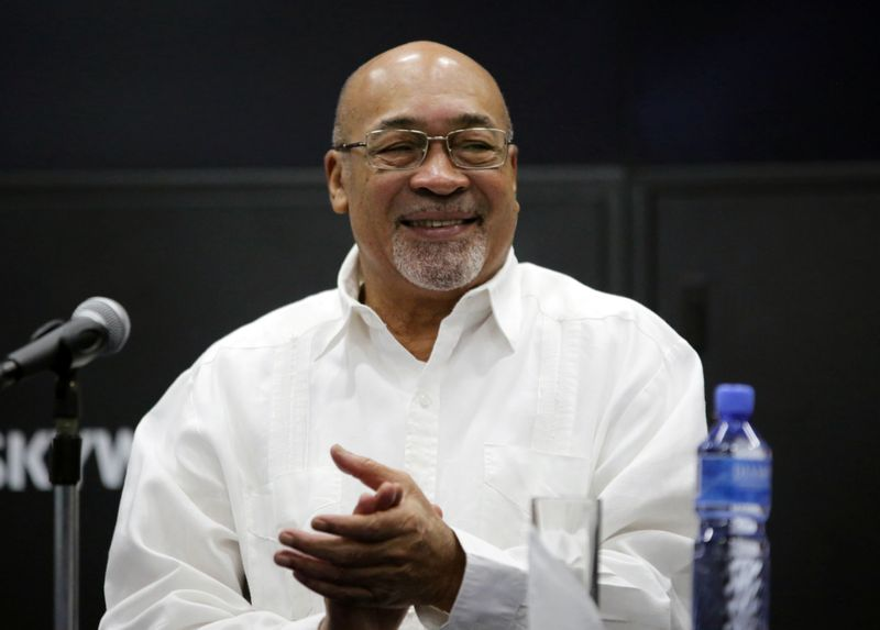 Suriname's President Desi Bouterse reacts during a news conference while announcing that Apache