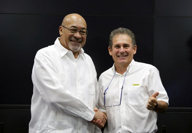 Suriname's President Desi Bouterse and Rudolf Elias, director of Suriname's state-owned oil