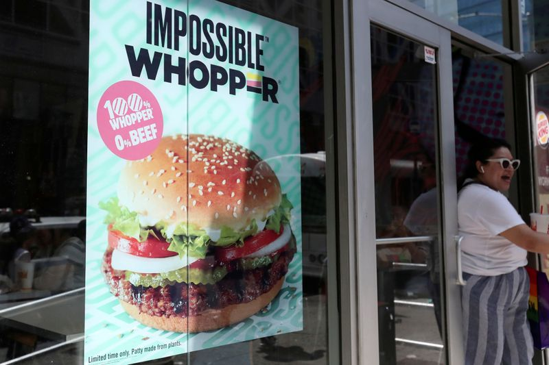 FILE PHOTO: A sign advertising the soy based Impossible Whopper is seen outside a Burger King