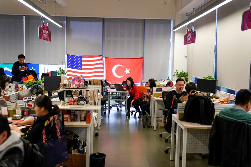 Employees work at AliExpress office at the Alibaba company's headquarters in Hangzhou