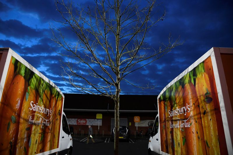 Signage for Sainsbury's is seen on delivery vans at a branch of the supermarket in London