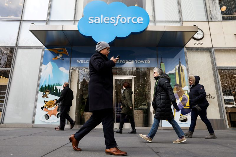 FILE PHOTO: People pass by the Salesforce Tower and Salesforce.com offices in New York