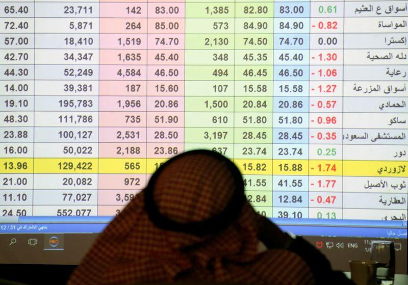 A Saudi trader monitors stocks at the Saudi stock market in Riyadh
