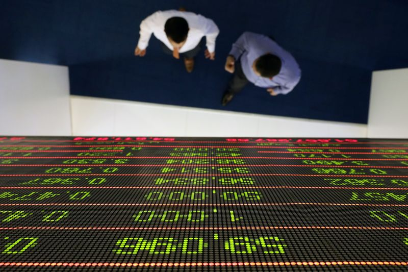 A trader uses a computer at the Doha Stock Exchange in Doha