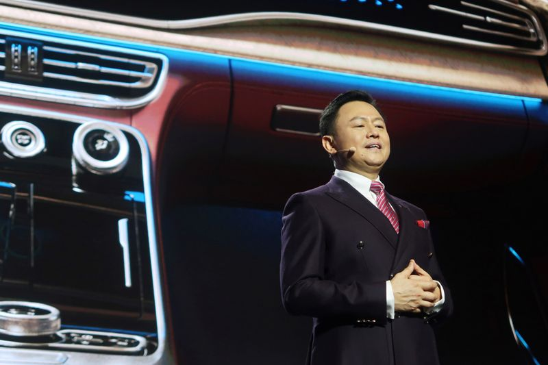Xu Liuping, chairman of China's FAW Group, speaks at an event of Chinese car marque Hongqi, or