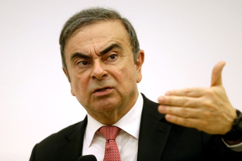 FILE PHOTO: Former Nissan chairman Carlos Ghosn gestures during a news conference at the