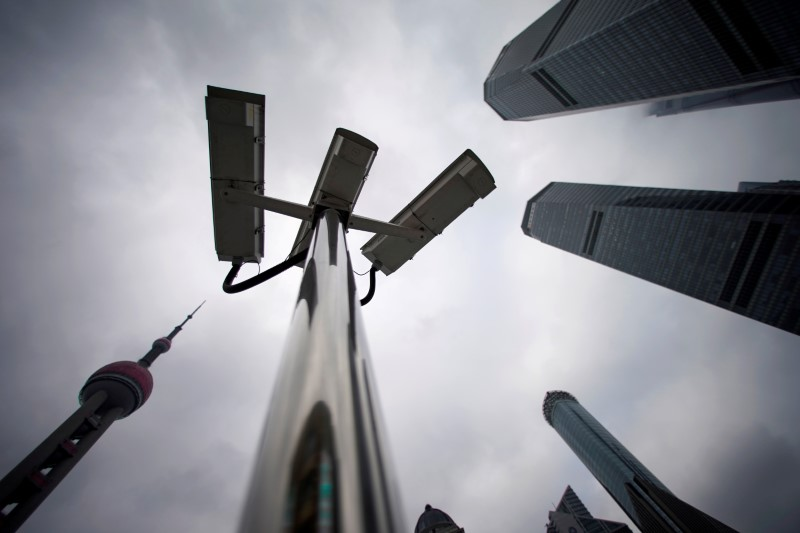 FILE PHOTO: Surveillance cameras are seen at Lujiazui financial district in Pudong, Shanghai