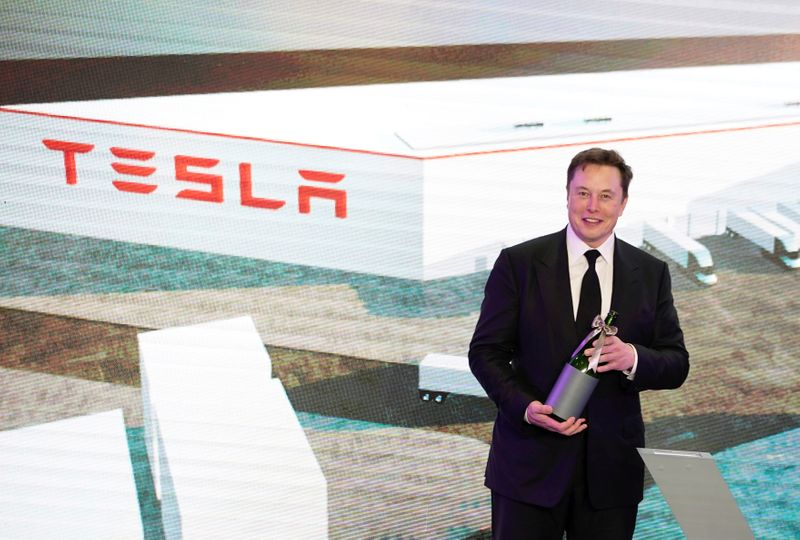 FILE PHOTO: Tesla Inc CEO Elon Musk attends an opening ceremony for Tesla China-made Model Y