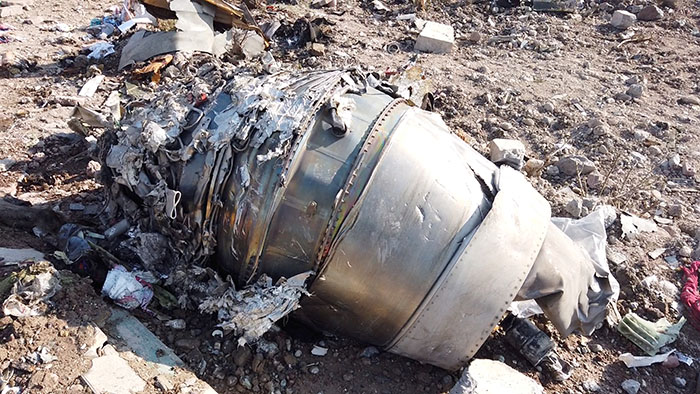 FILE PHOTO: A part of the wreckage of the downed Malaysia Airlines Flight MH17 is seen at its