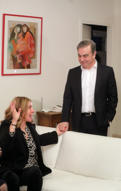 Former Nissan chairman Carlos Ghosn and his wife Carole Ghosn arrive for a Reuters interview in