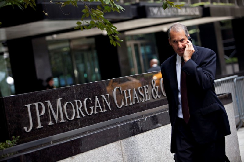 FILE PHOTO: Man walks past JP Morgan Chase's international headquarters on Park Avenue in New