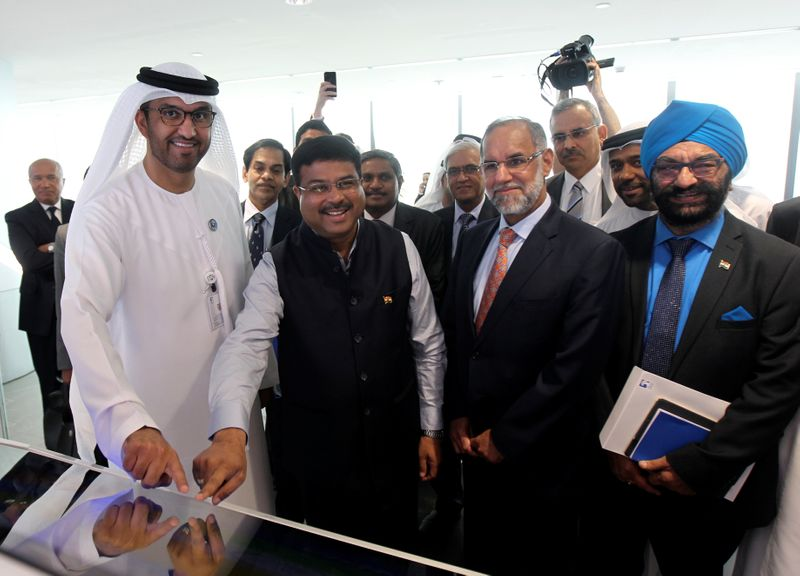 Staff are seen at the Panorama Digital Command Centre at the ADNOC headquarters in Abu Dhabi